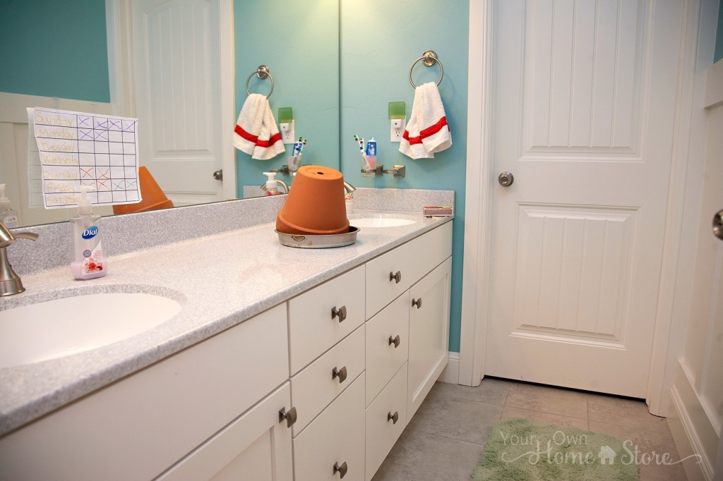 white bathroom with  clay pot on the counter