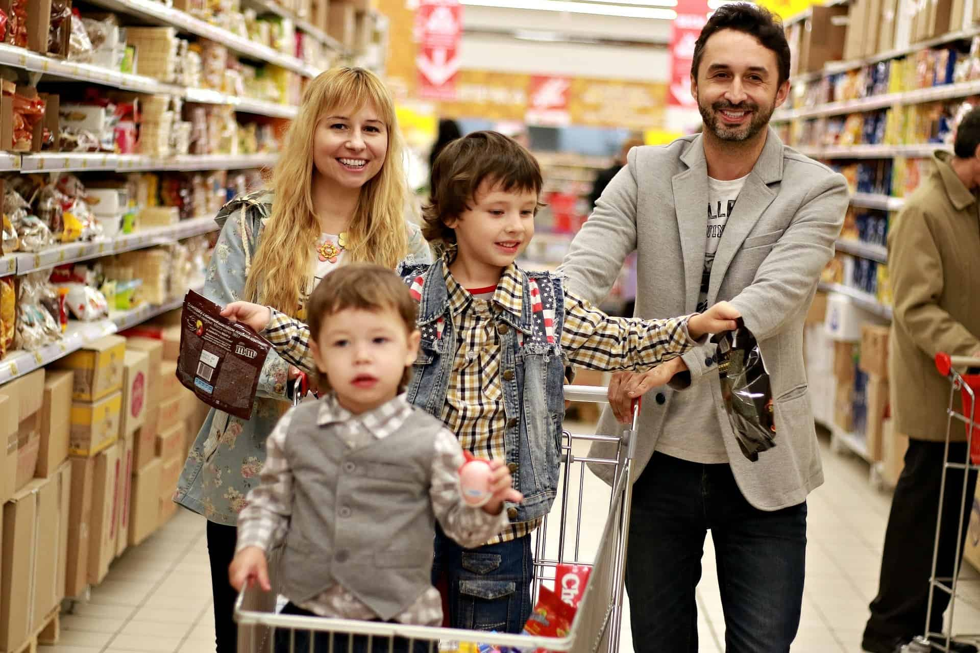 whole Family buying foods and other things needed for storage in their home