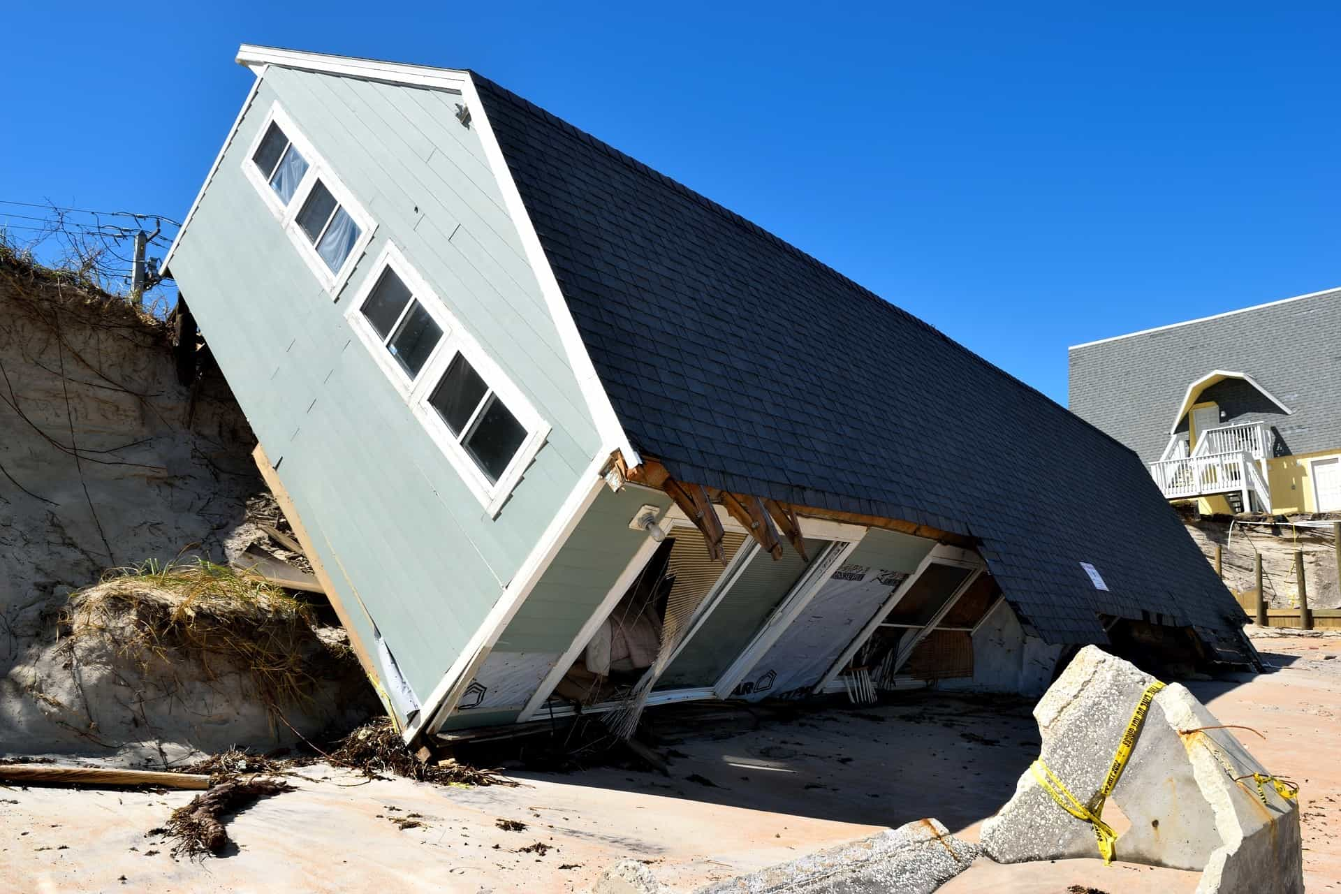 flat house knocked over by high winds during a hurricane