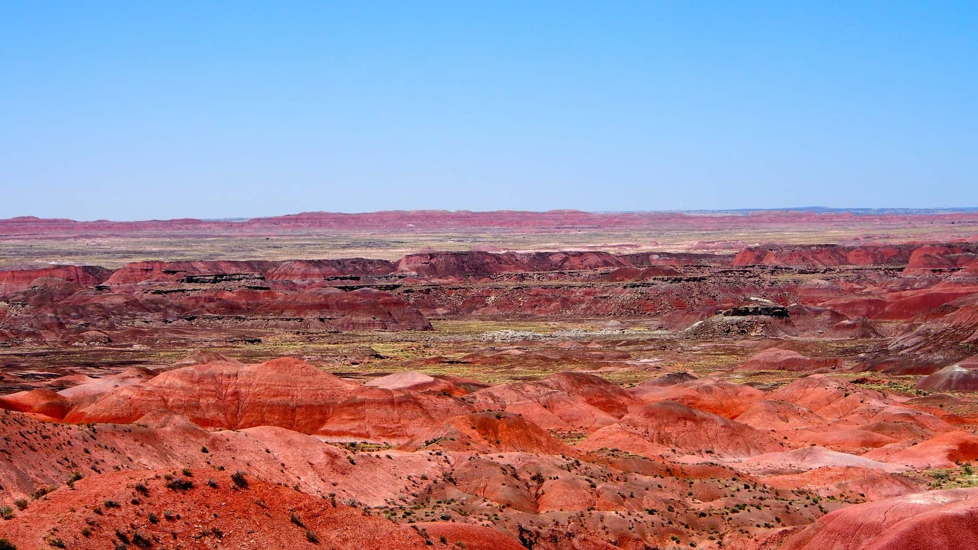 blue sky with the red horizon of the painted desert in Arizona