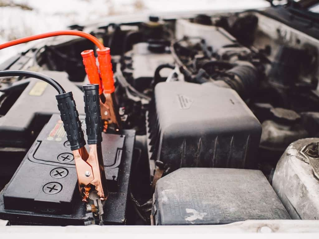 Car battery engine with jumper cables