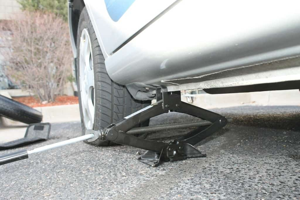 Flat tire using car survival kit to fix