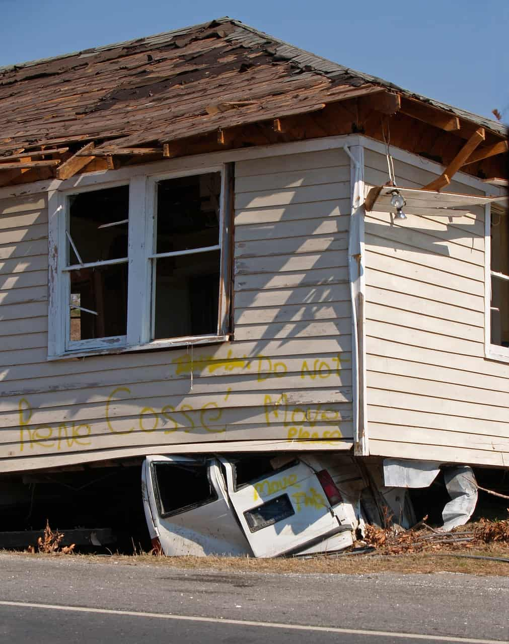 house crushed in extreme weather event